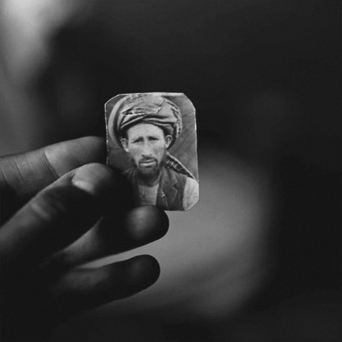 The Victor Weeps: Afghanistan (Abdul Aziz holding a photograph of his brother, Mula Abdul Hakim) 1997